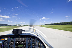 View from small aircraft taking off from runway Stock Photography