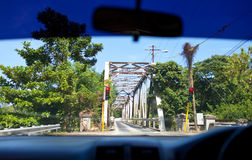 View of the small bridge with serial movement from a car window. Jamaica. Royalty Free Stock Photo
