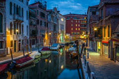View into a small canal in Venice at night Stock Photo