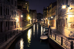 View into a small canal in Venice at night Royalty Free Stock Image