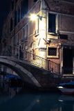 View into a small canal in Venice at night Stock Photography