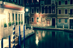 View into a small canal in Venice at night Stock Images