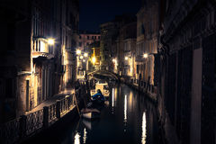 View into a small canal in Venice at night Stock Image