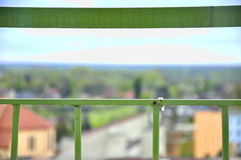 View for small city from dangerous balcony`s barrier. That`s a view from balcony`s barrier royalty free stock photos