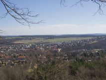 View on small city mnisek pod brdy in czech republic with trres,. Castle and buildings, early spring, blue sky background Stock Image