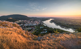 View of Small City with River from the Hill at Sunset Stock Images