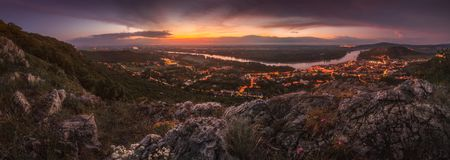 View of Small City with River from the Hill at Sunset. View of Small City of Hainburg an der Donau with Danube River as Seen from Rocky Hundsheimer Hill at Royalty Free Stock Photography