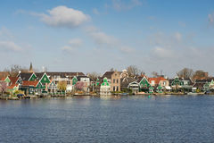 View of small Dutch village on the river shore, the Netherlands Royalty Free Stock Images