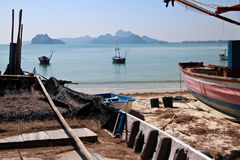 View of Small Fishing Boats in a Placid Sunny Bay on the Coast of Thailand Royalty Free Stock Image
