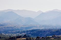 View of small Greek village surrounded by mountains, Crete, Greece stock photo