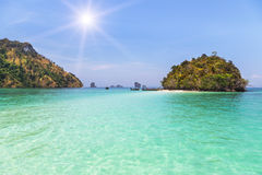 View of small island with longtail boats in andaman sea Stock Image