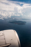View on small islands in sea, from plane window Stock Photo