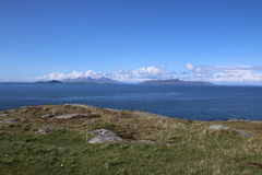 View of The Small Isles. This picture shows a view of The Small Isles: Rum, Muck and Egg. They are located off The West Coast of Scotland. The foreground shows Stock Images