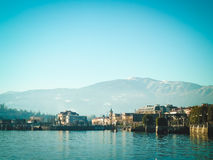 View of small italic town from embankment. Landscape, mountains and lake. Royalty Free Stock Photography