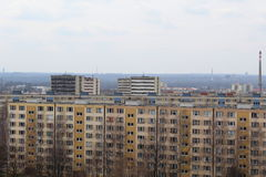 View of small and large apartment buildings. Multi-storey residential buildings have colorful facades. Before each building is a lawn and sidewalk. There are Royalty Free Stock Photography