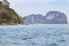 view of small limestone island on the tropical beach in andaman sea Stock Photography