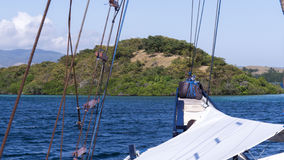 View of small lush island from front of sailing ship Stock Photos