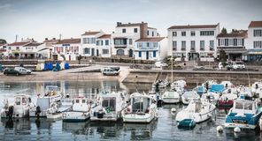 View of the small port where maneuver fishing boats in Port Joinville stock photo