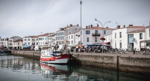 View of the small port where maneuver fishing boats in Port Joinville stock images