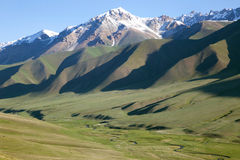 View Small river in alpine meadows. Tien-Shan mountains Royalty Free Stock Image