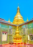The main stupa of Su Taung Pyae Pagoda in Mandalay, Myanmar. The view on small stupa in inner courtyard and the main one, dominating over Su Taung Pyae Pagoda stock photography