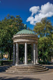 View of small temple and cyclists at Villa Borghese in Rome. royalty free stock image