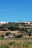 Farmland and white village, Medina Sidonia. Royalty Free Stock Photo