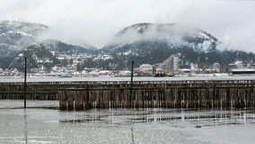 View of small town Namsos, Norway. The view of small town Namsos , Norway, in the misty spring day. The floating timber fence used to store timber and now it is Stock Images