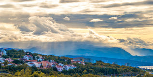 View of a small town in the valley, stormy skies. Royalty Free Stock Image