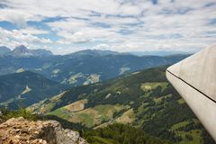 View on small village in Alpine valley in south tyrol. View from Kronplatz peak to Italian Alps Royalty Free Stock Image