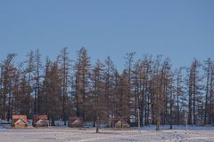 Small house near forest on frozen Lake Khovsgol with blue sky background Stock Image