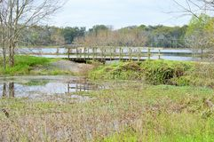 View of small wooden bridge over stream Royalty Free Stock Photos