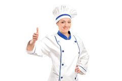 A view of a smiling baker giving  thumb up Stock Image