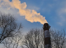 The view of smoke from a big pipe. Royalty Free Stock Photos