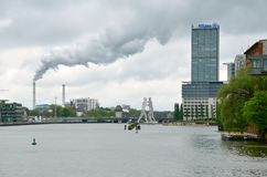 View on smoke from the chimney in Berlin, Germany. Stock Photography