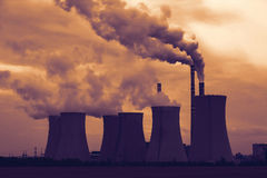 View of smoking coal power plant at sunset Stock Photography