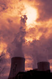 View of smoking coal power plant at sunset Royalty Free Stock Photo