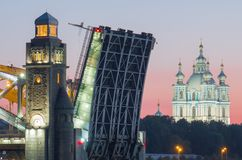View of the Smolny Cathedral and the divorced Bolsheokhtinsky bridge during the white nights. St. Petersburg. Russia stock photos