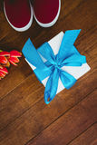 View of sneakers and blue gift Stock Images