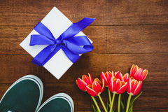 View of sneakers and blue gift Royalty Free Stock Images