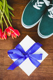 View of sneakers and blue gift Stock Photography