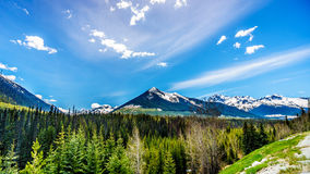 View of the snow capped Coast Mountains along Highway 99, also called The Duffey Lake Road. Winds its way through the Coast Mountain Range between Pemberton Royalty Free Stock Image