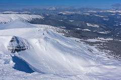 А view from the snow-capped peak. Royalty Free Stock Photography