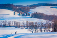 View of snow covered farm fields and houses in rural York County royalty free stock photo