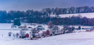 View of snow covered farm fields and houses in rural York County Stock Image