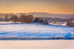 View of snow-covered farm fields and the Pigeon Hills near Spring Grove, Pennsylvania. royalty free stock photography