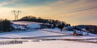 View of snow-covered farm fields and rolling hills in rural Carr Stock Photos