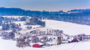 View of snow-covered farm fields and rolling hills in rural York Royalty Free Stock Image