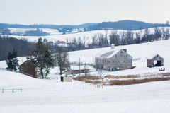 View of a snow covered farm and rolling hills, near Shrewsbury, Royalty Free Stock Images