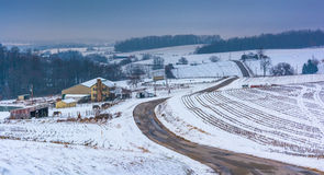 View of snow covered hills and fields in rural York County, Penn Stock Photography